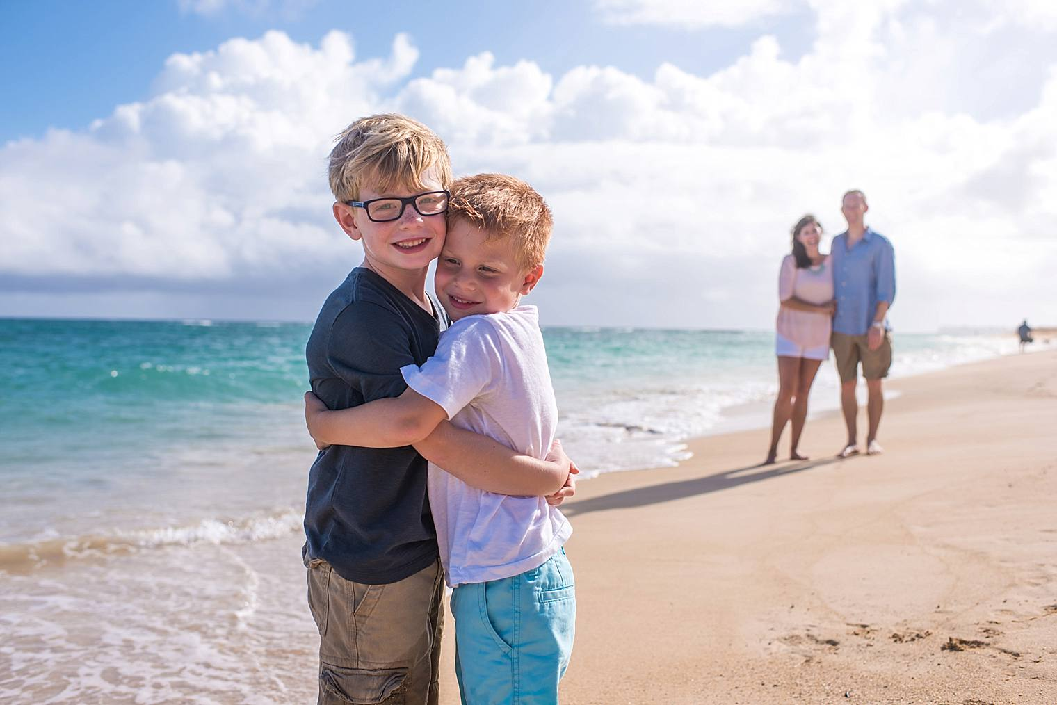 brothers on the beach by maui family photographer angela nelson