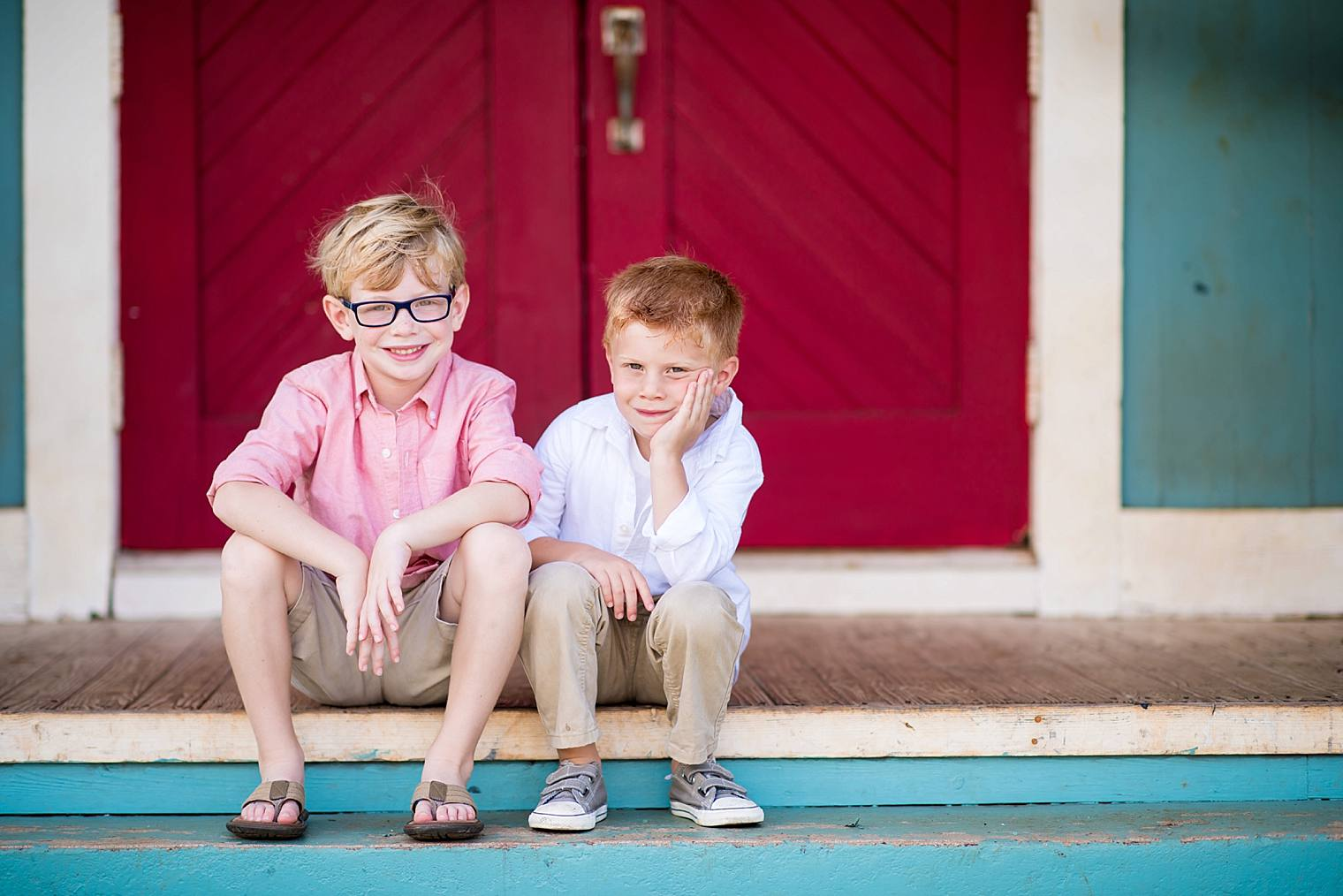brothers on the steps of a church in Maui
