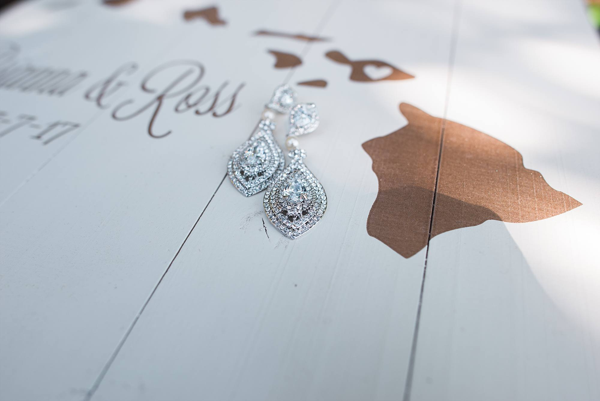Wedding invitation and bride's earrings
