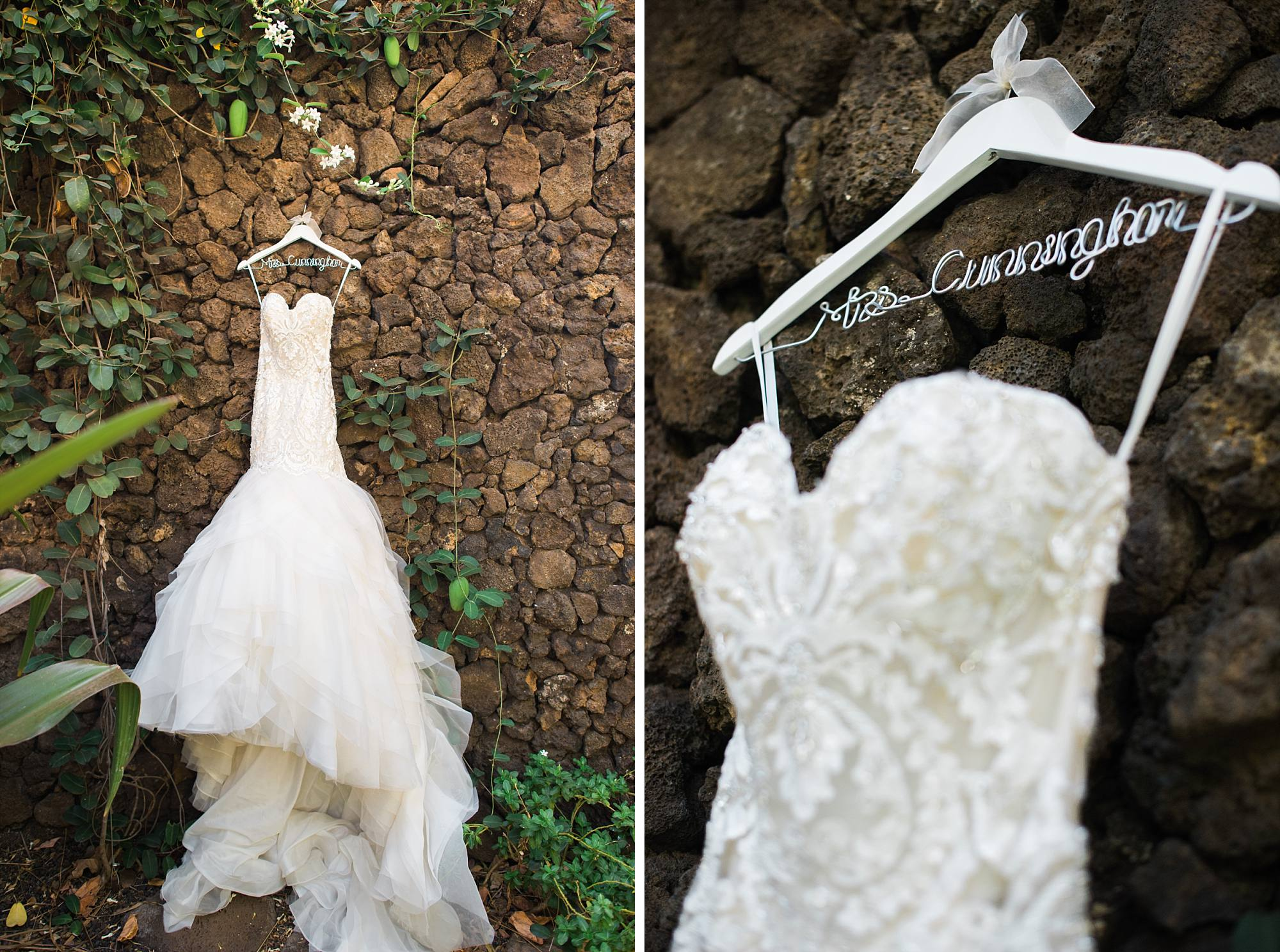 eve of Milady wedding dress showcased on a rock wall in Maui