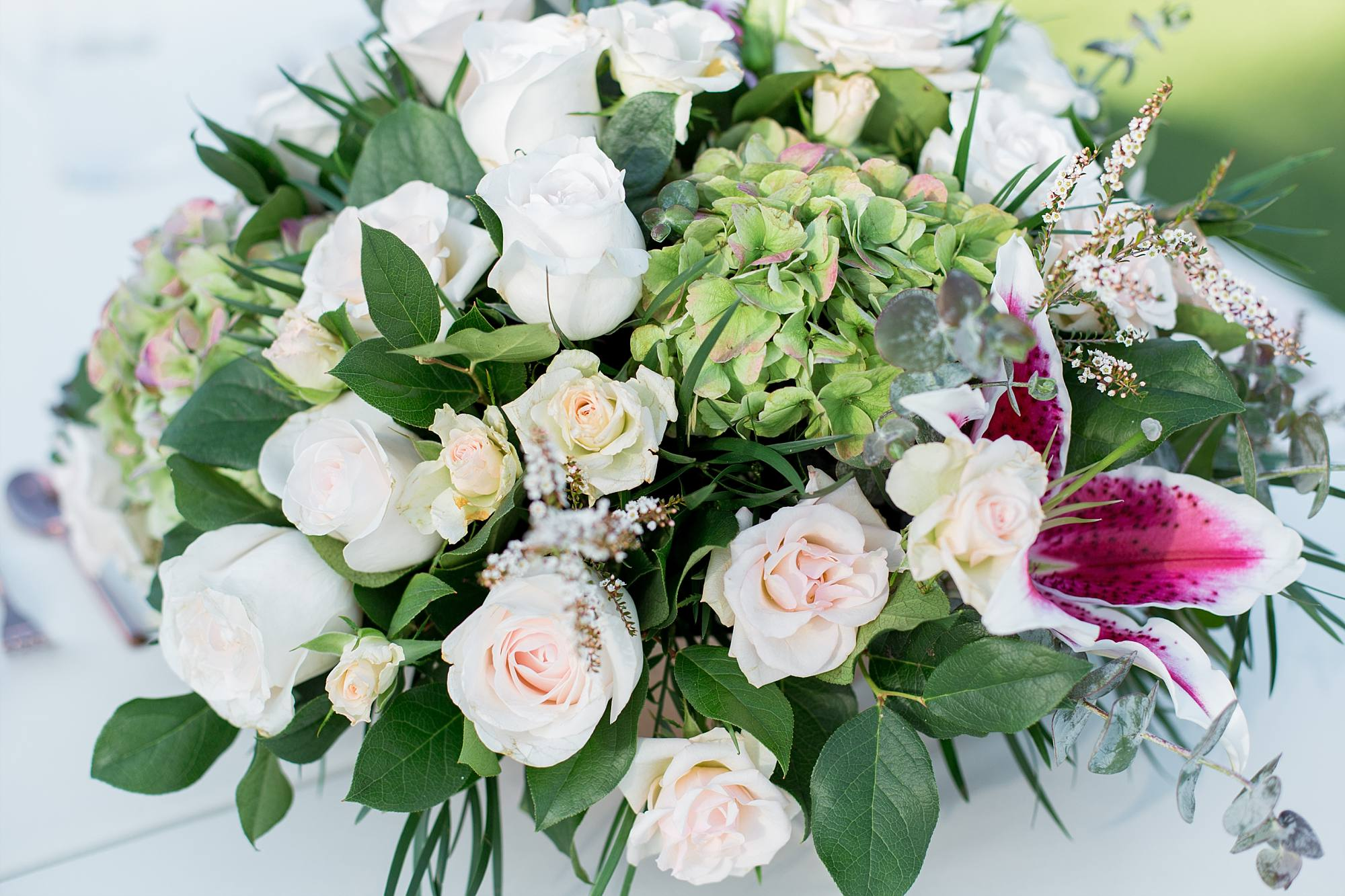 Flower wedding centerpiece. light pink roses adn greenery