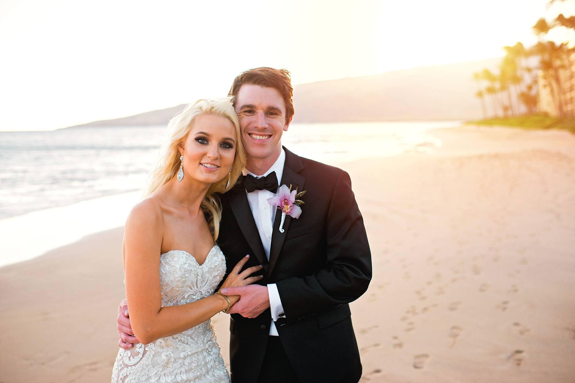 wedding bride and groom photoshoot on beach at beginning of sunset