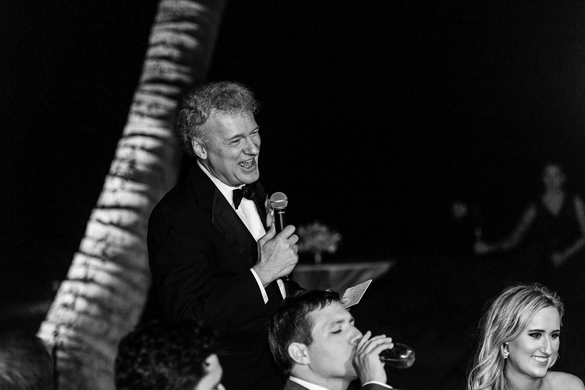 father of the bride giving his speech to the happy couple