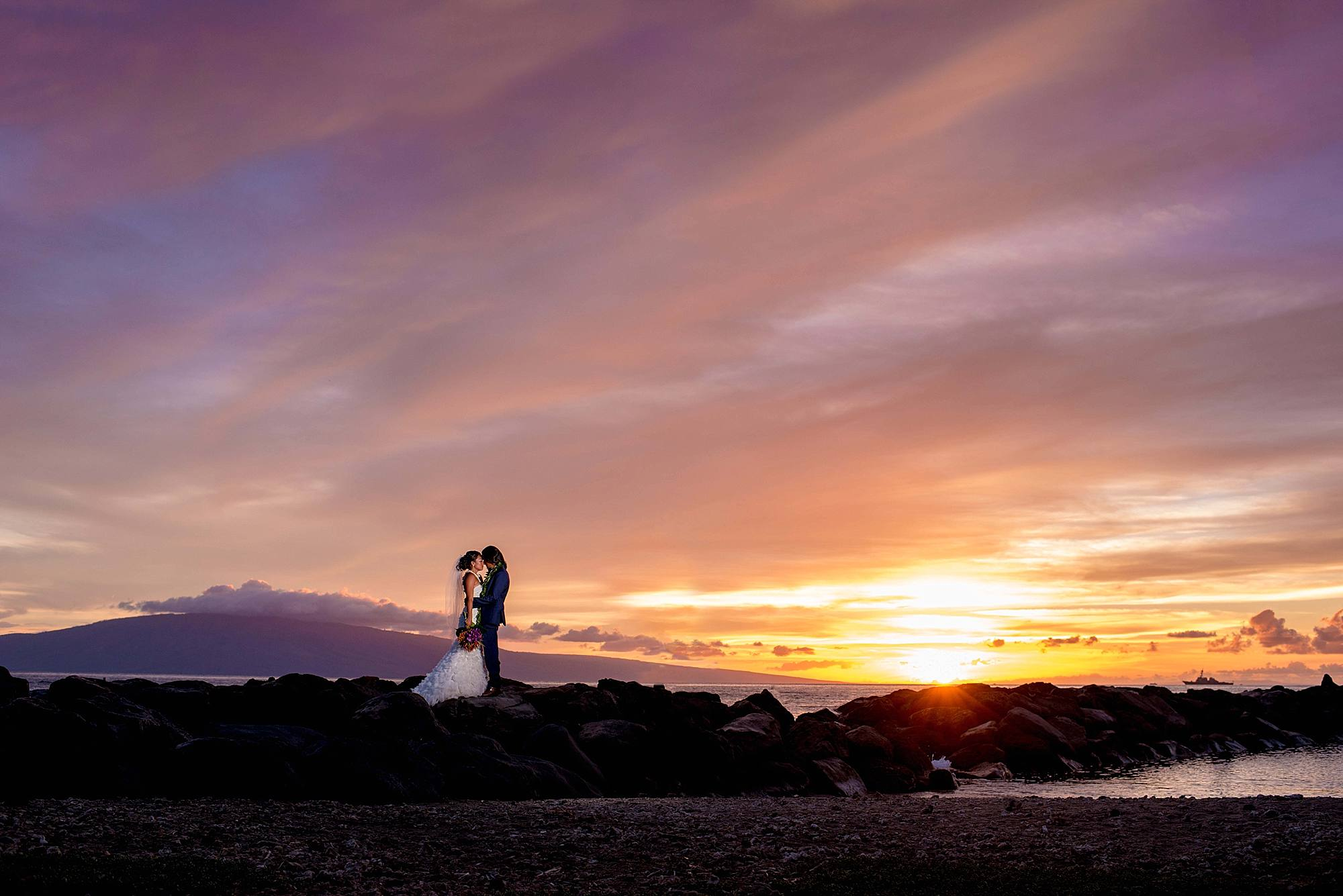 sunset in lahaina, hawaii with bride and groom