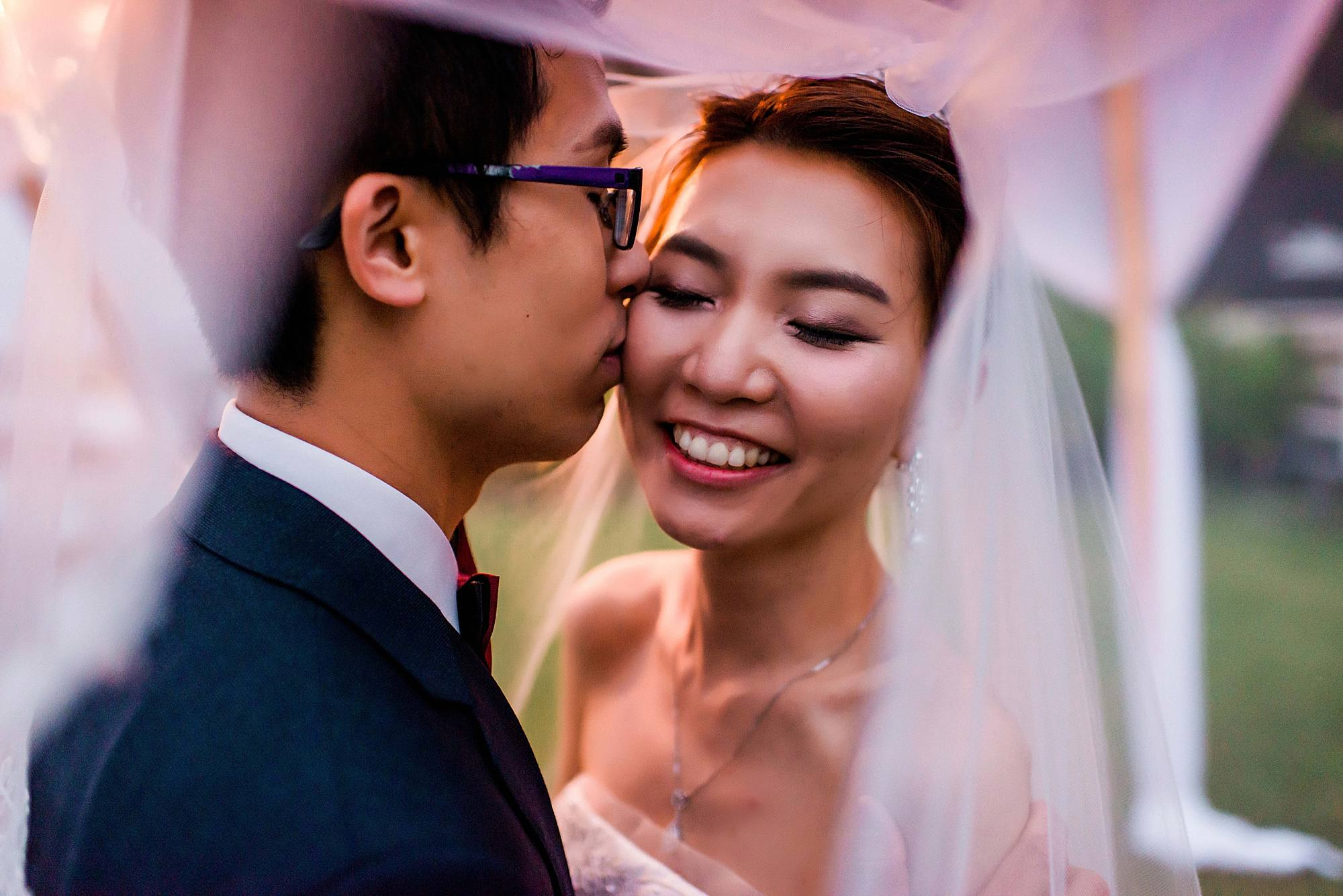 white orchid beach house wedding asian couple