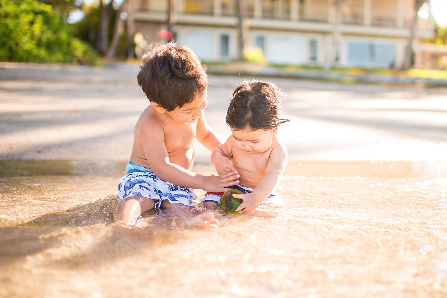 brothers playing in the water in maui