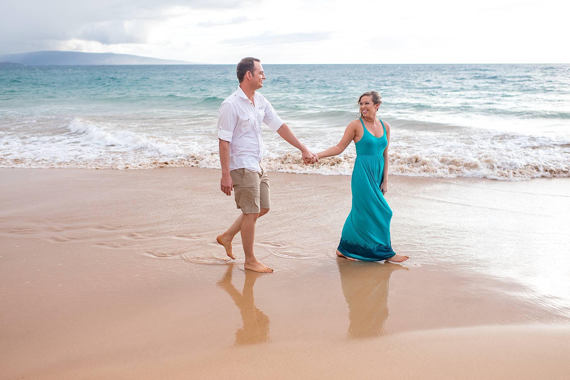 couple walking on the beach in maui, hawaii