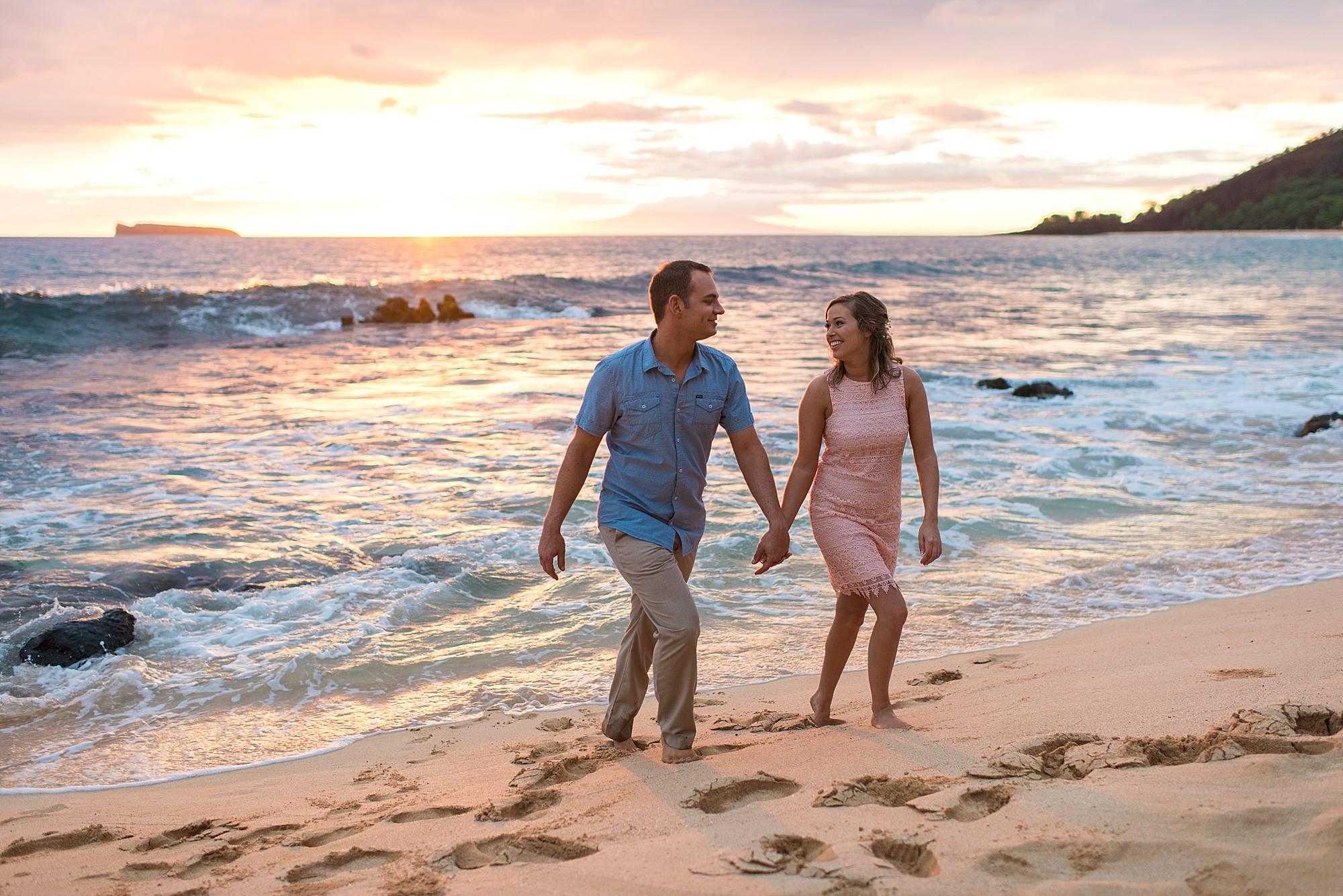 couple in love on the beach in maui, hawaii