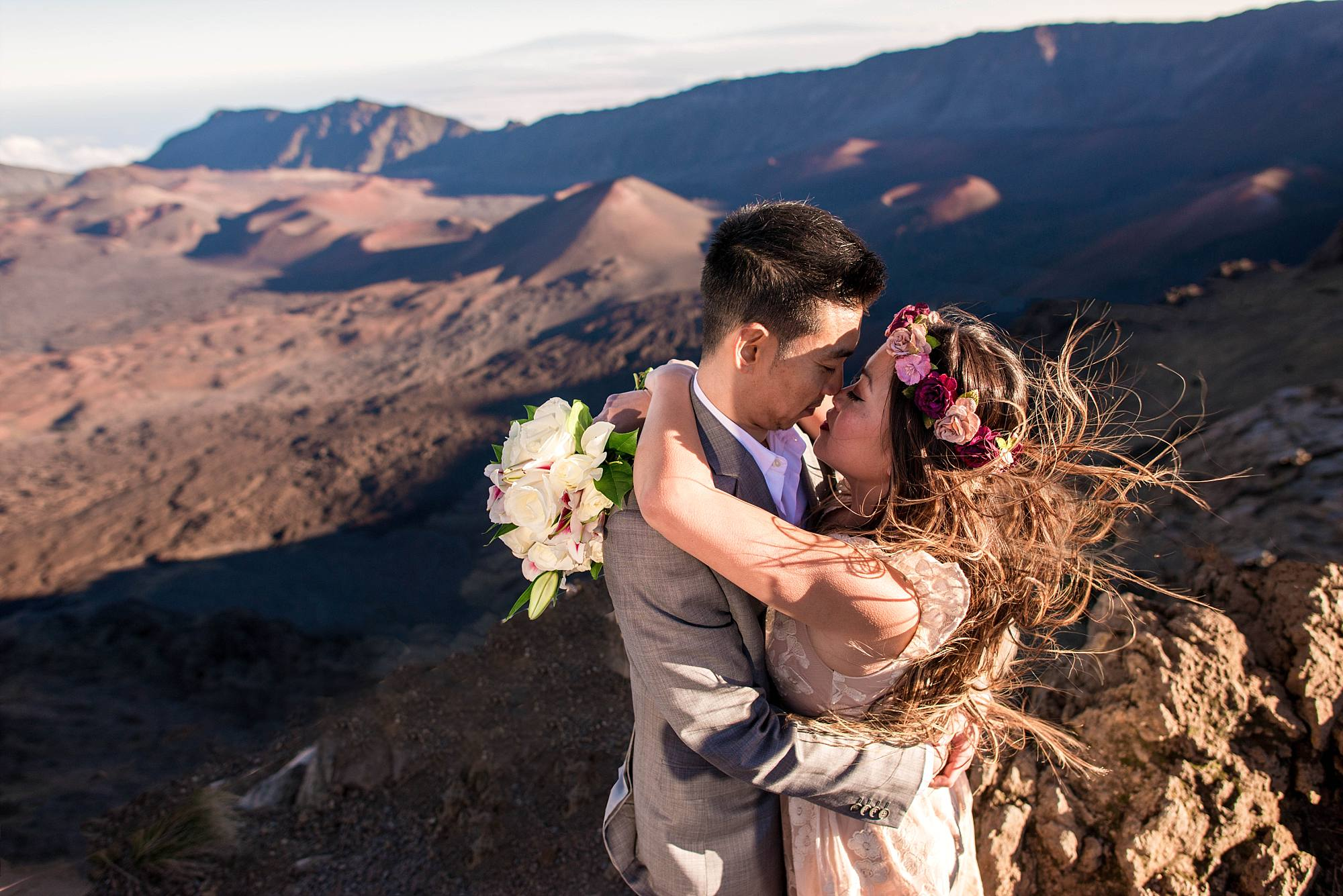 wedding couple hugging, wind blowing hair