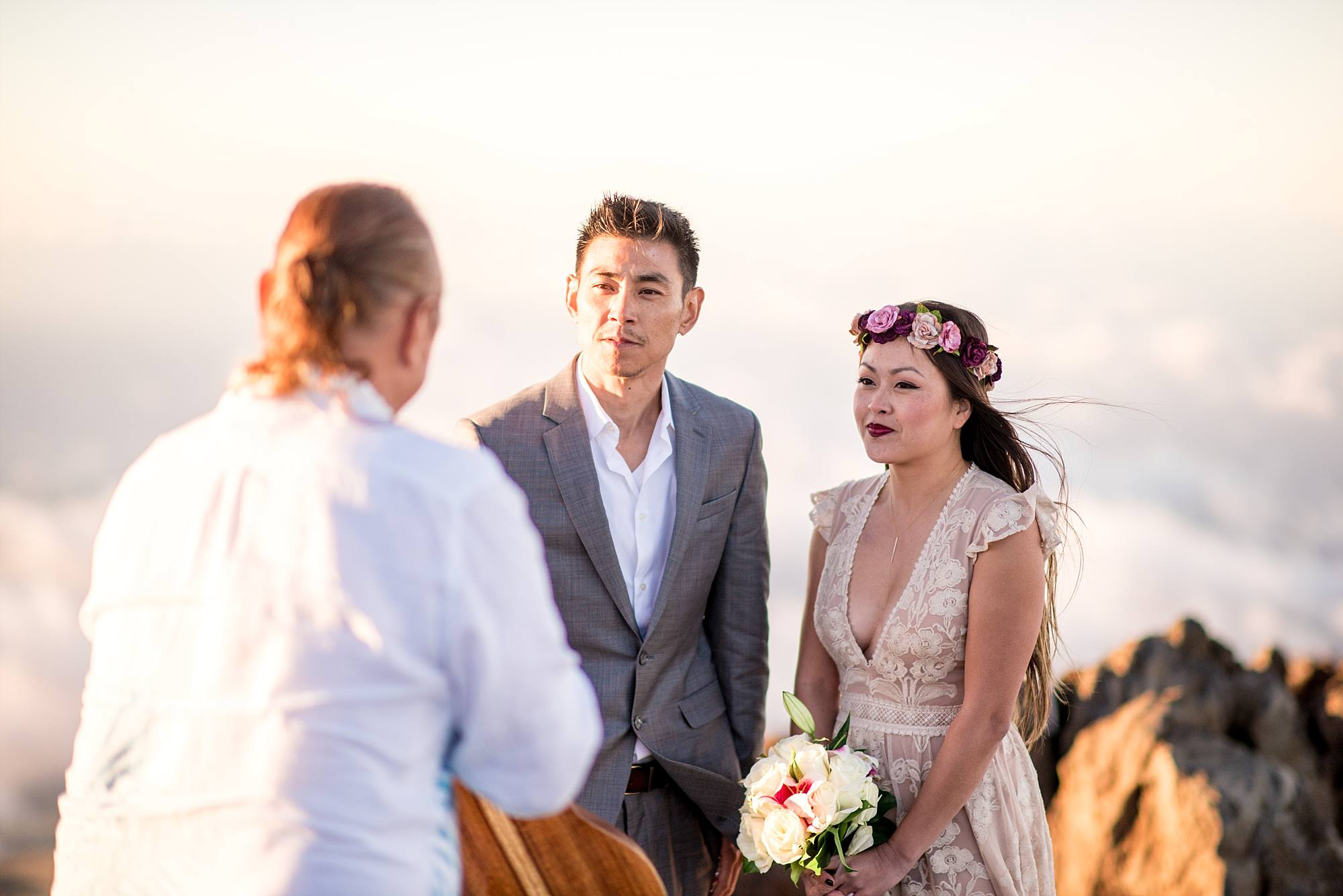 couple facing officiant during ceremony