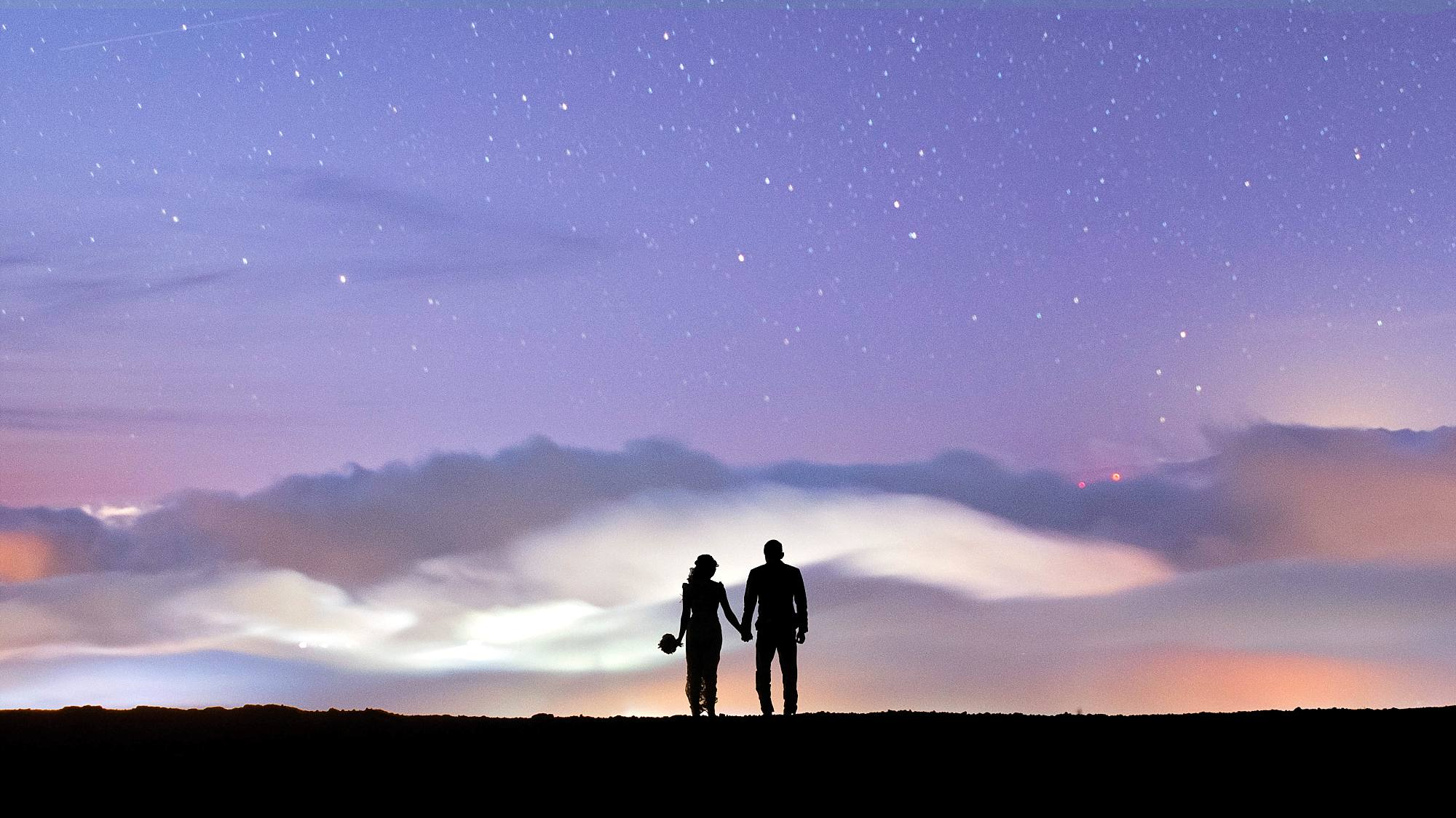newlyweds silouette against a starry Maui night