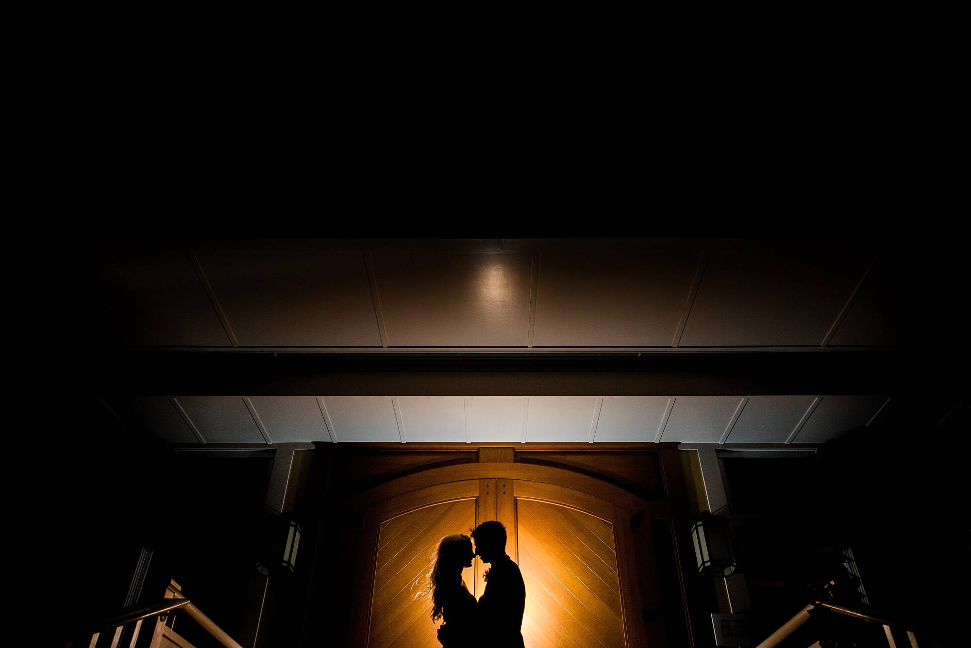 night time bride and groom silhouette shot in front of Sugar Beach Events wedding