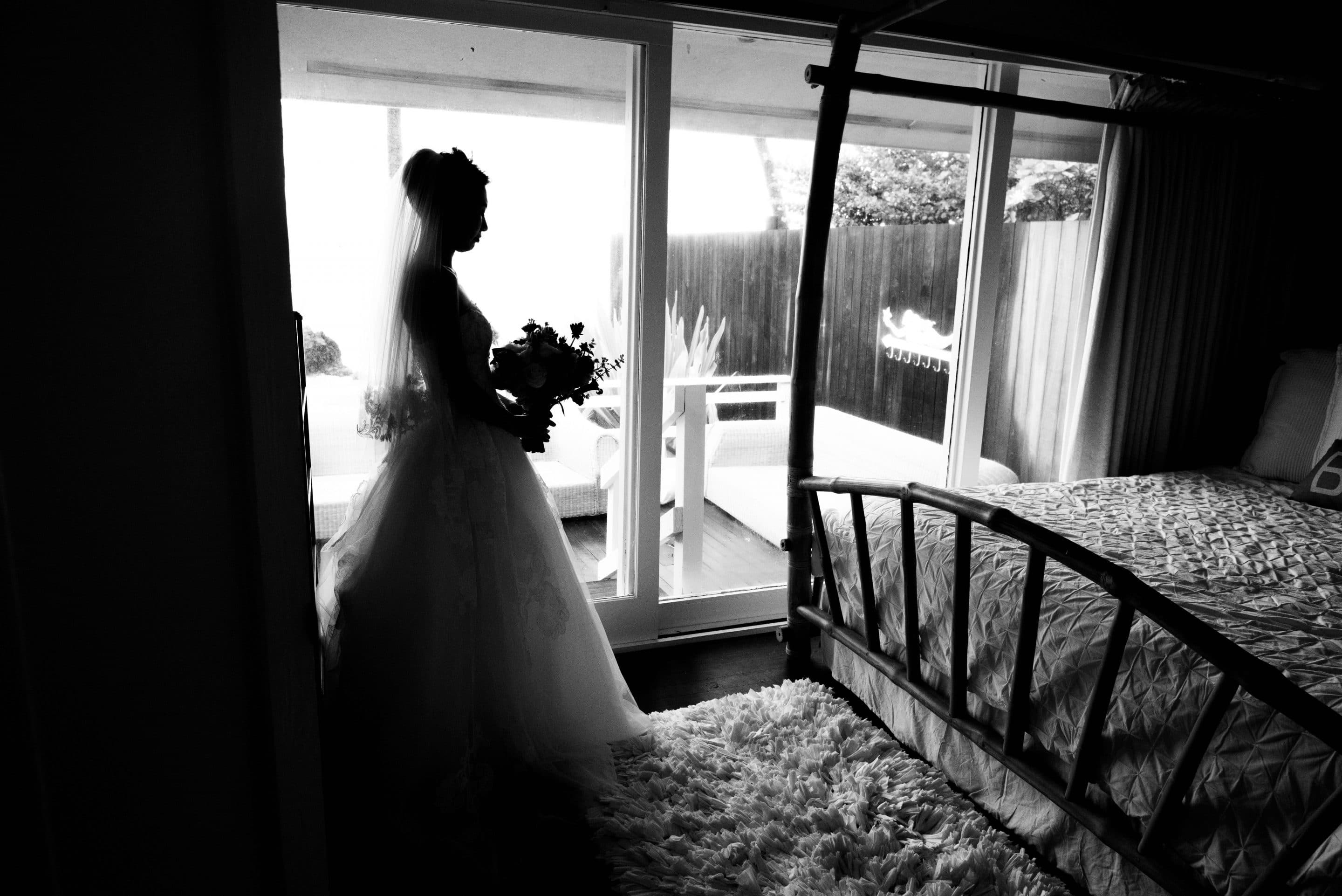 bride getting ready at white orchid beach house
