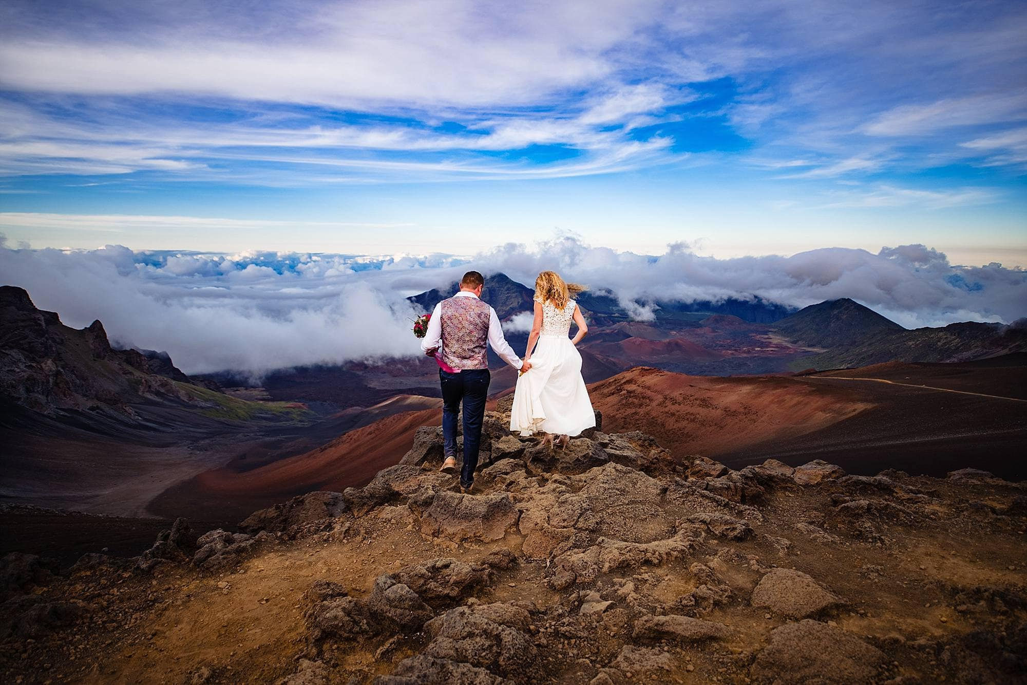 sliding sands trail on Haleakala with bride and groom