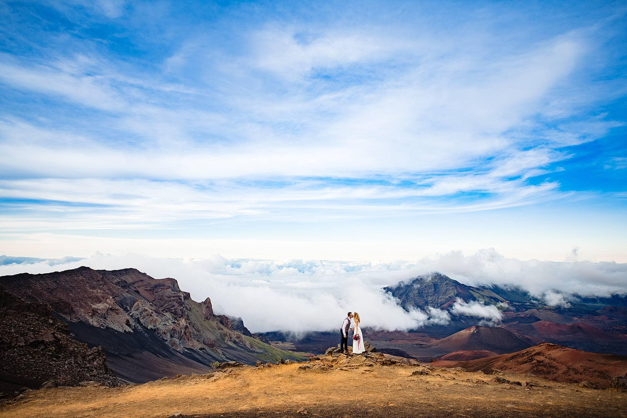 couple kissing in haleakala crater