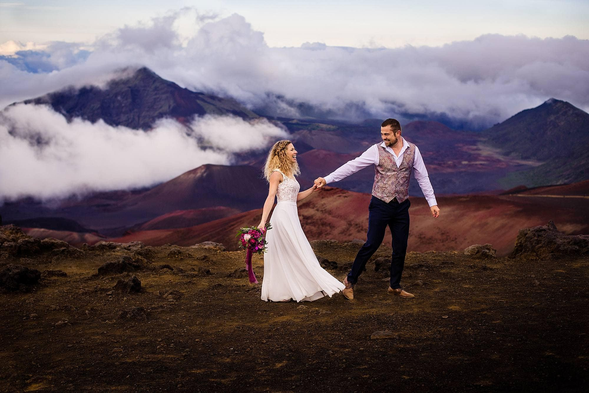 bride and groom enjoying maui's volcano