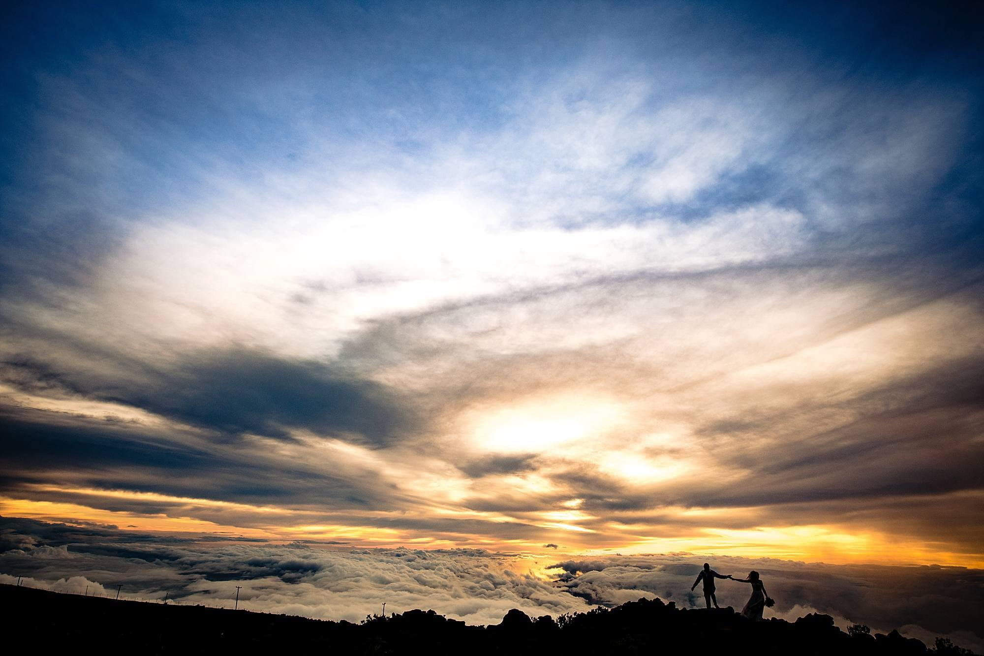 silhouette of bride and groom on haleakala