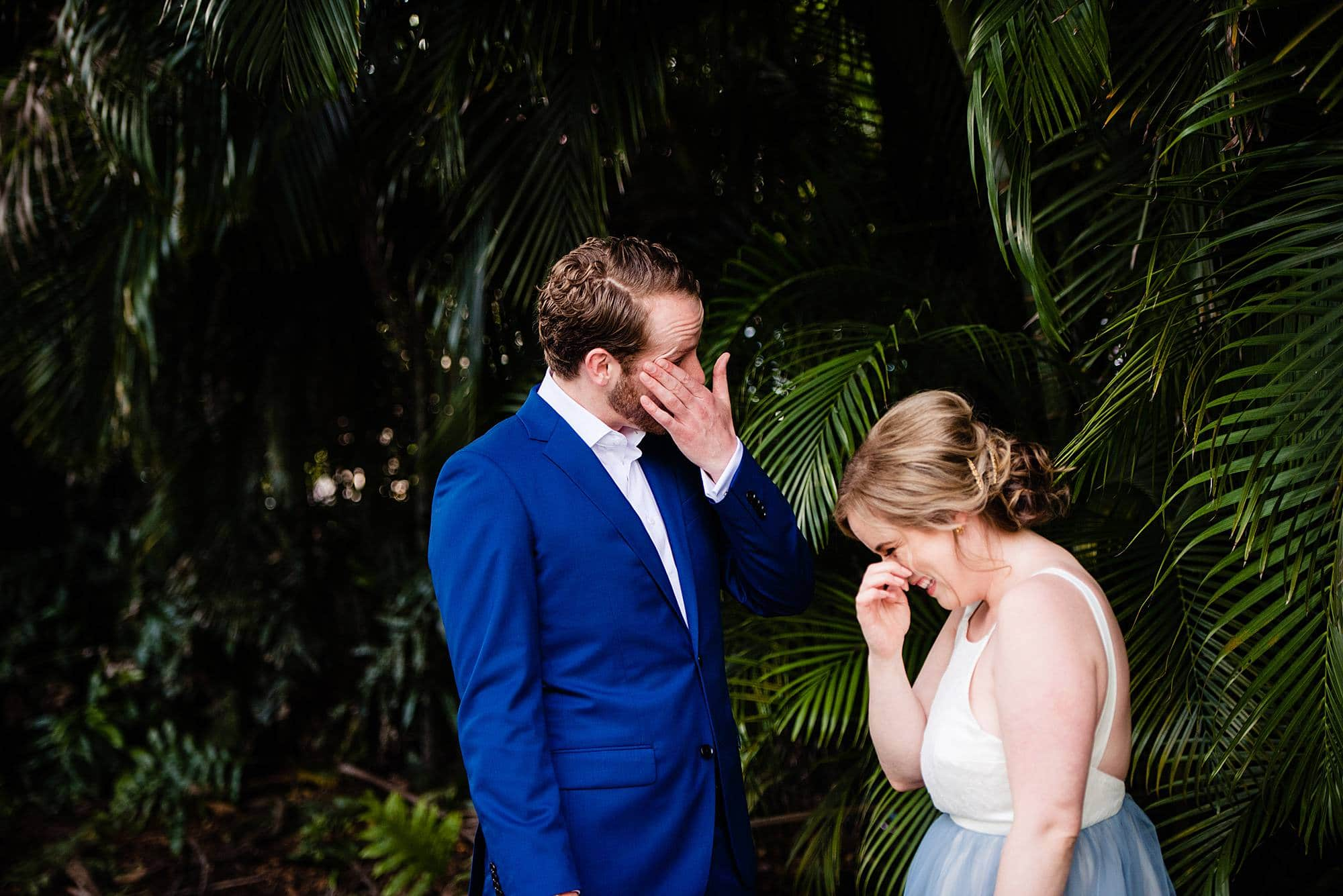 couple wiping away tears after their first look