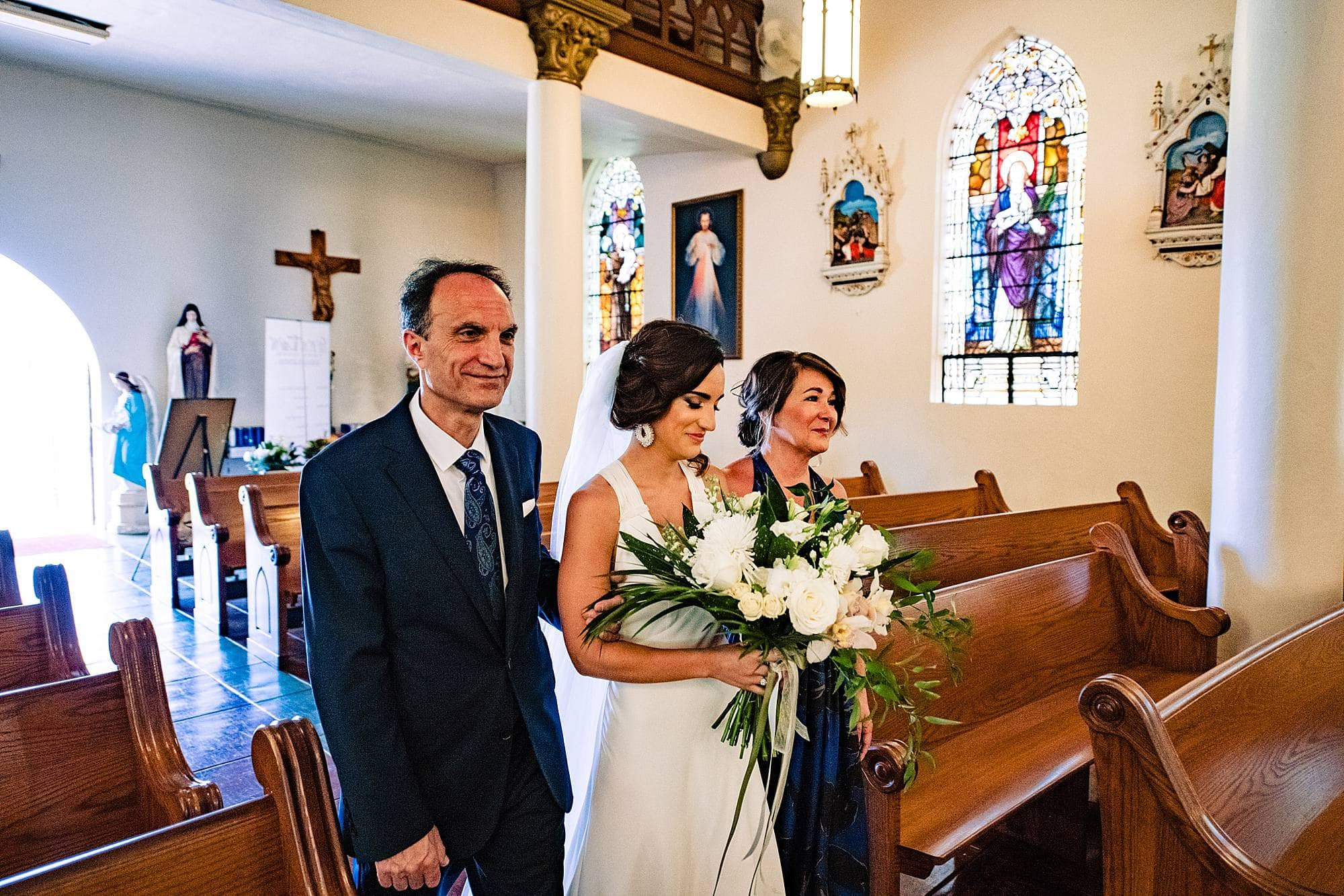 bride walking down the aisle at st.joseph church in makawao