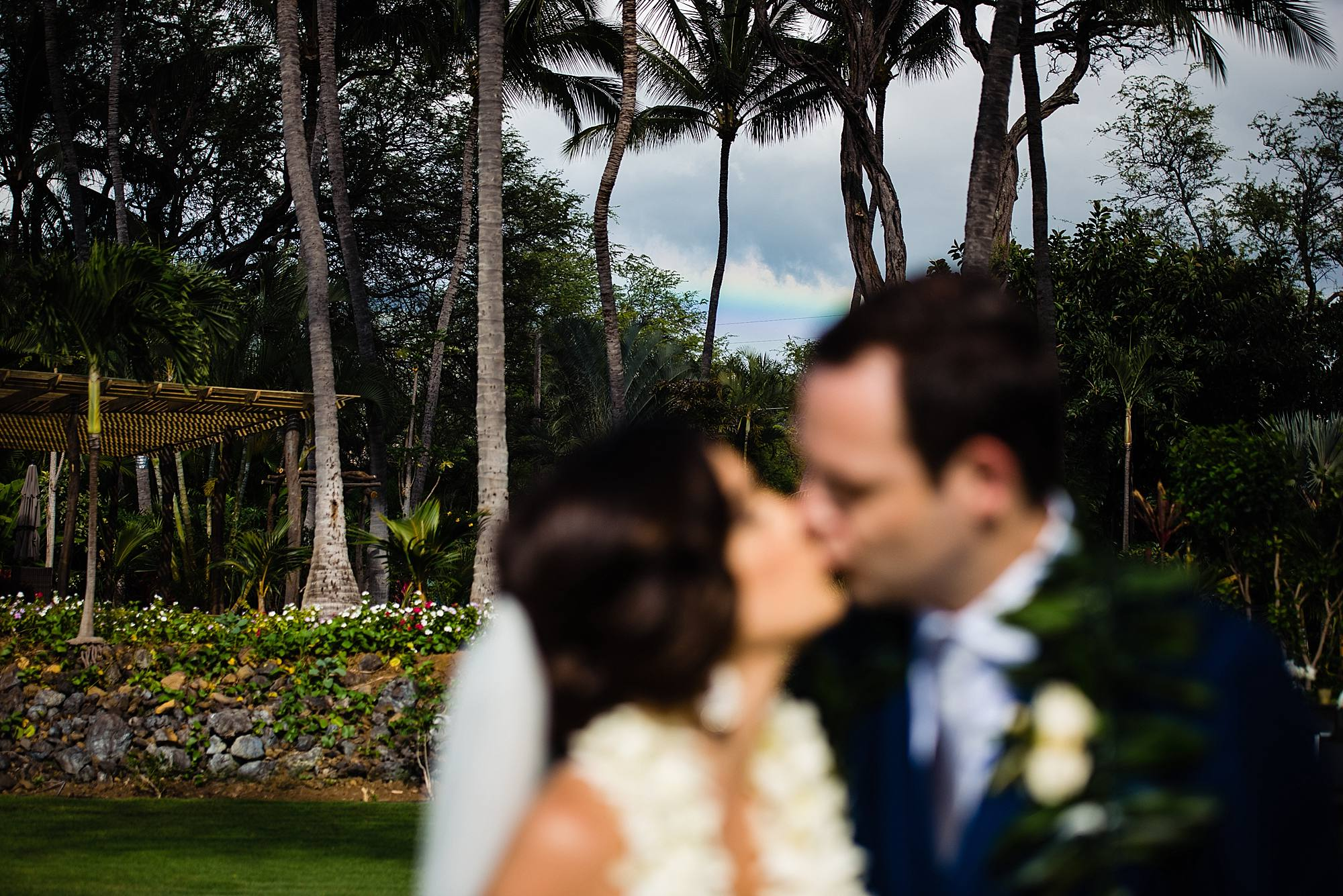 bride and groom with rainbow at ponomakena sanctuary