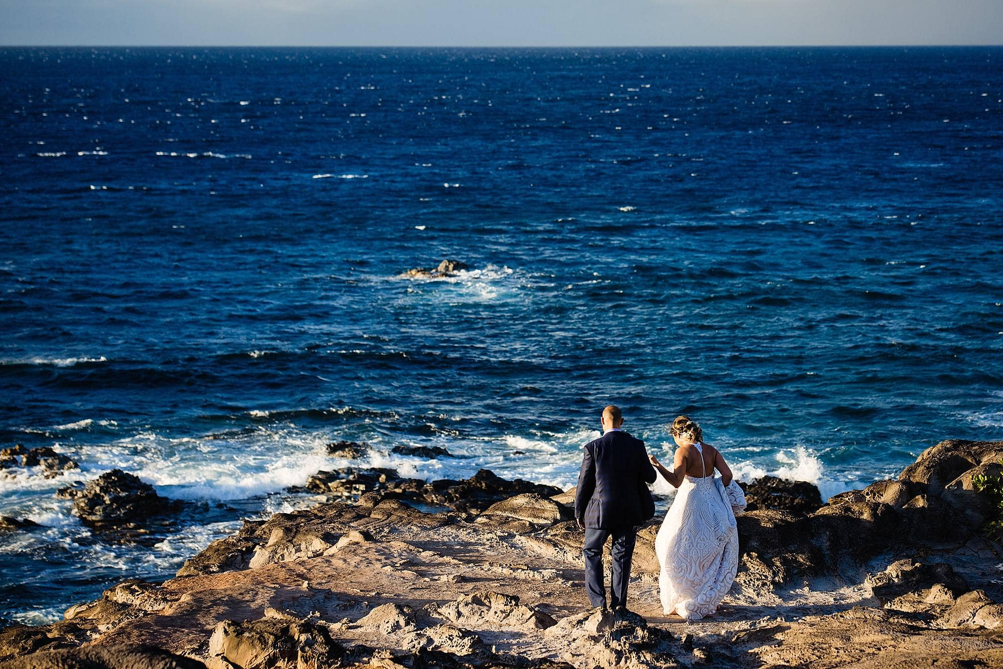 wedding couple on cliff in maui