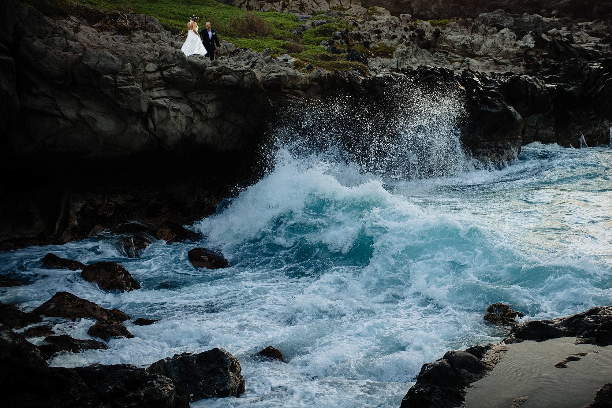 wave crashing on cliff at kapalua
