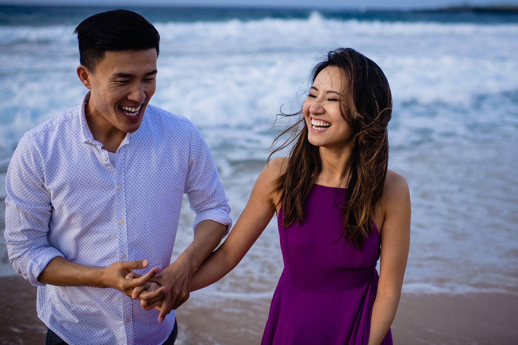 fun couple's engagement shoot on beach in maui