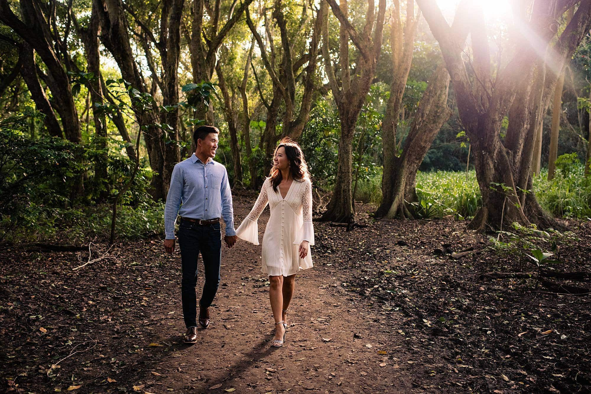 couple walking in jungle in maui