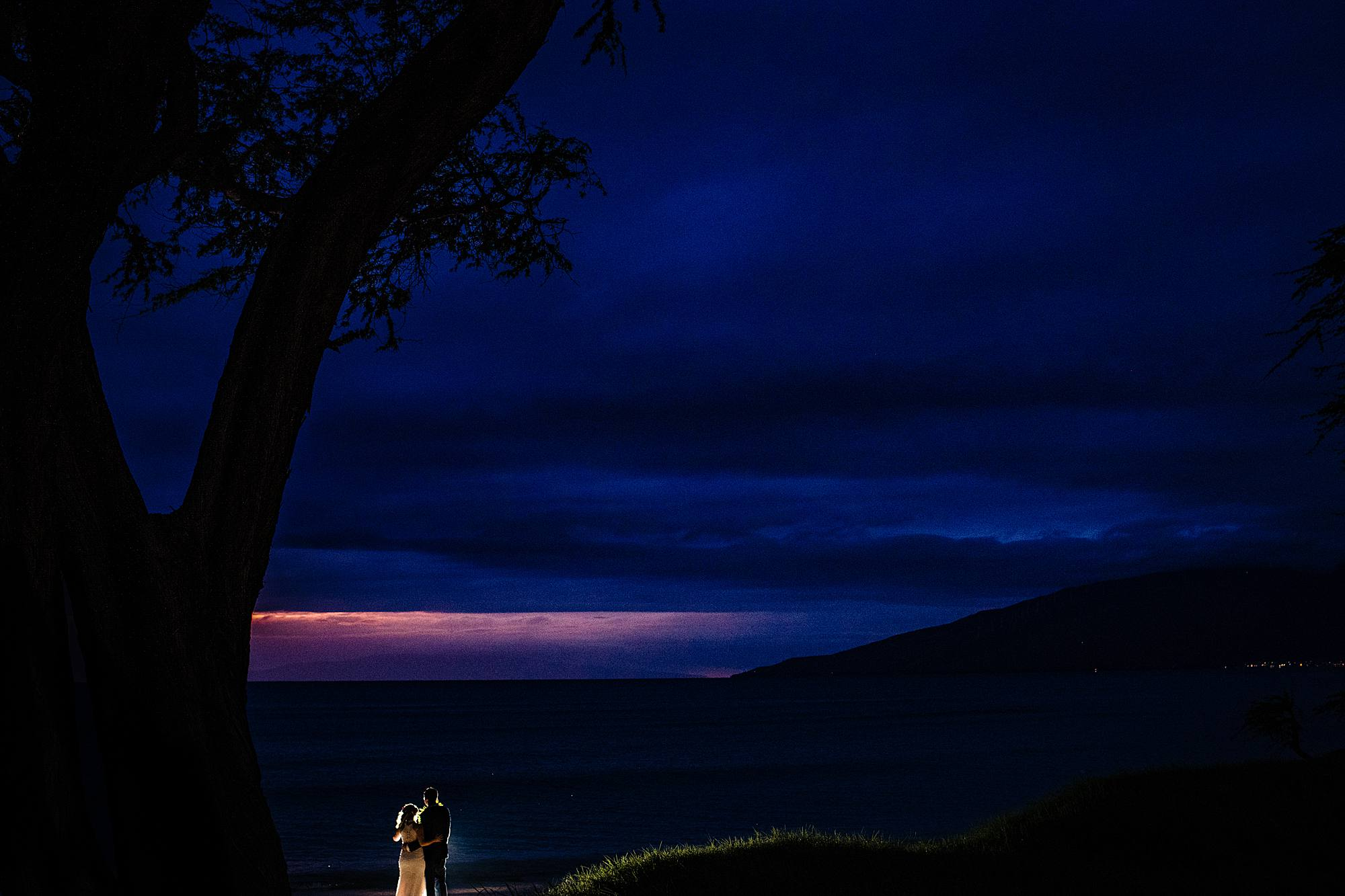 sunset in kihei hawaii with bride and groom