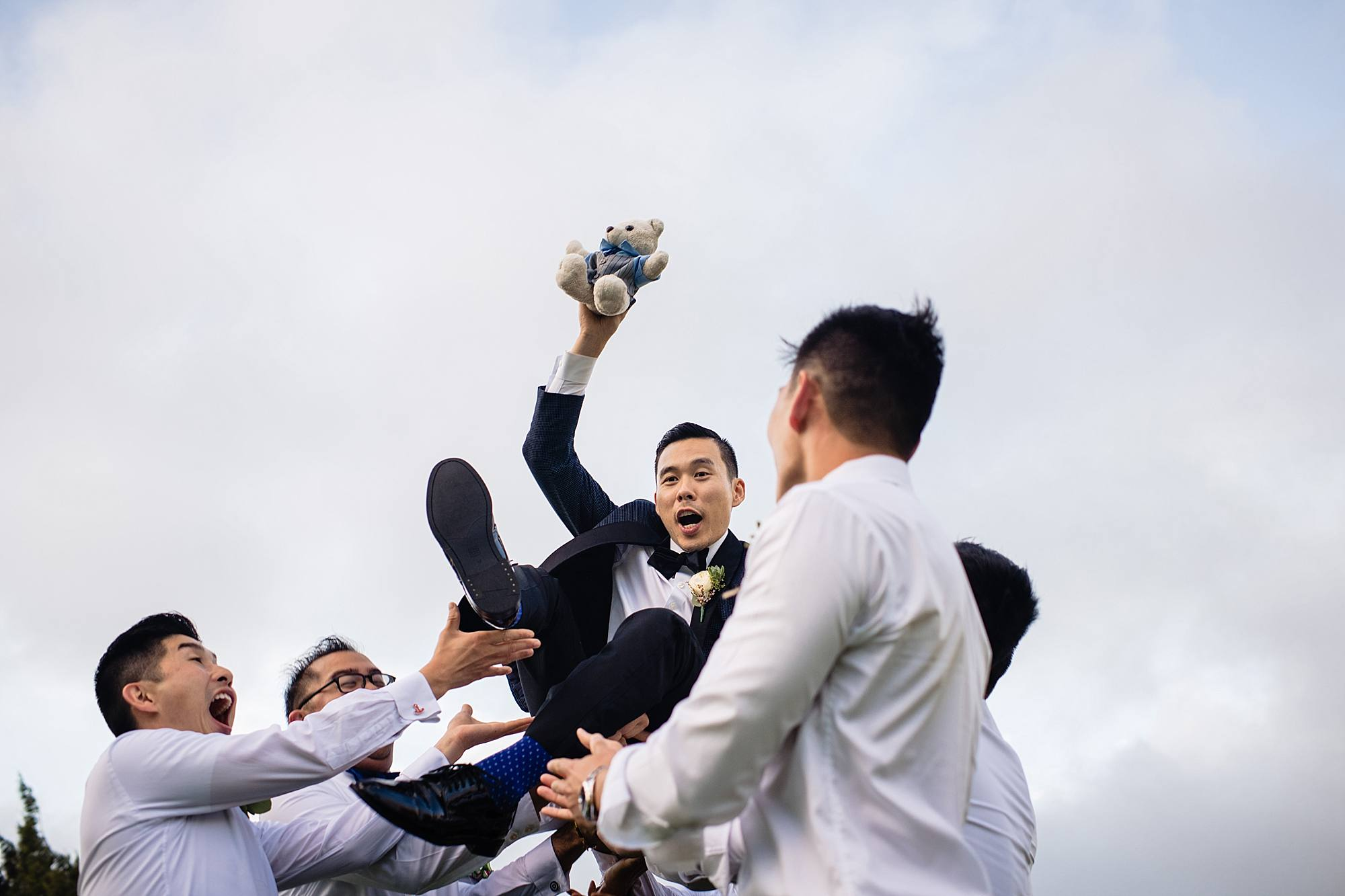 groom being thrown in the air