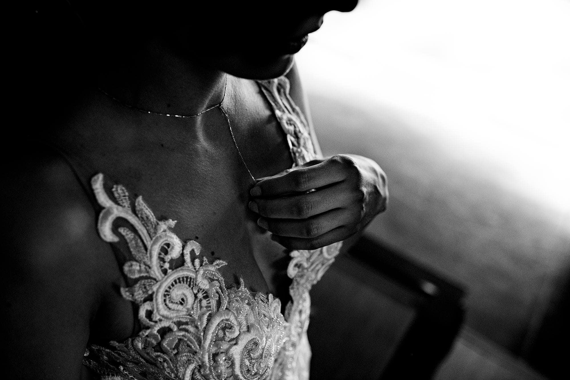 bride putting on her jewelry