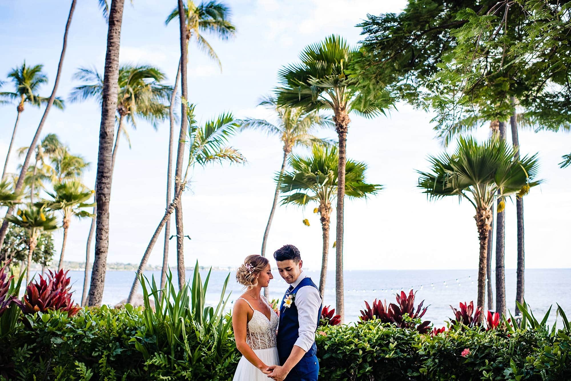 bride and groom during first look at hyatt maui