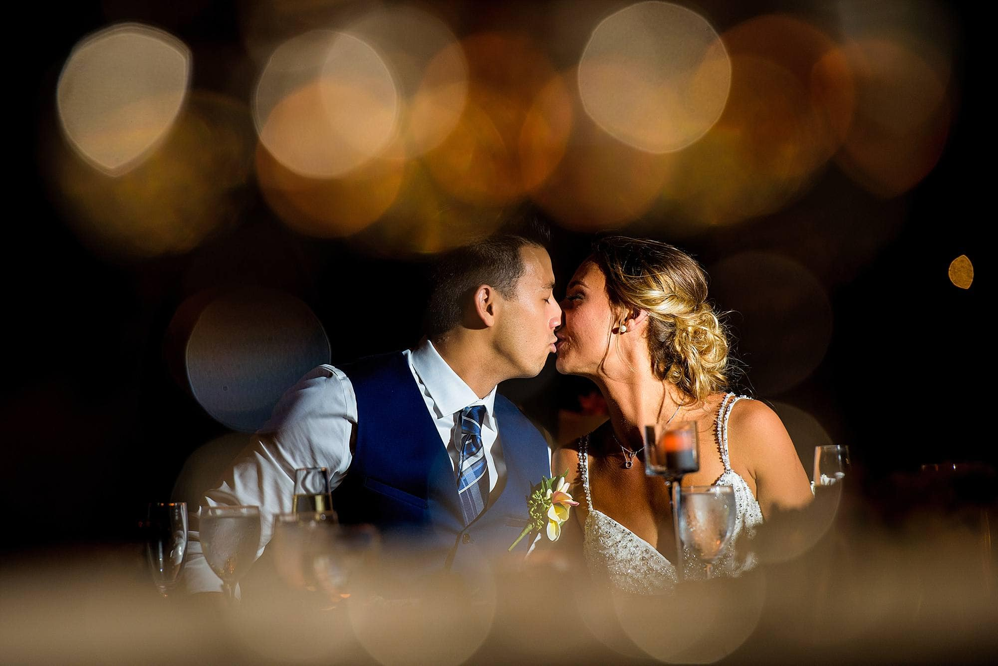 bride and groom kissing at hyatt maui