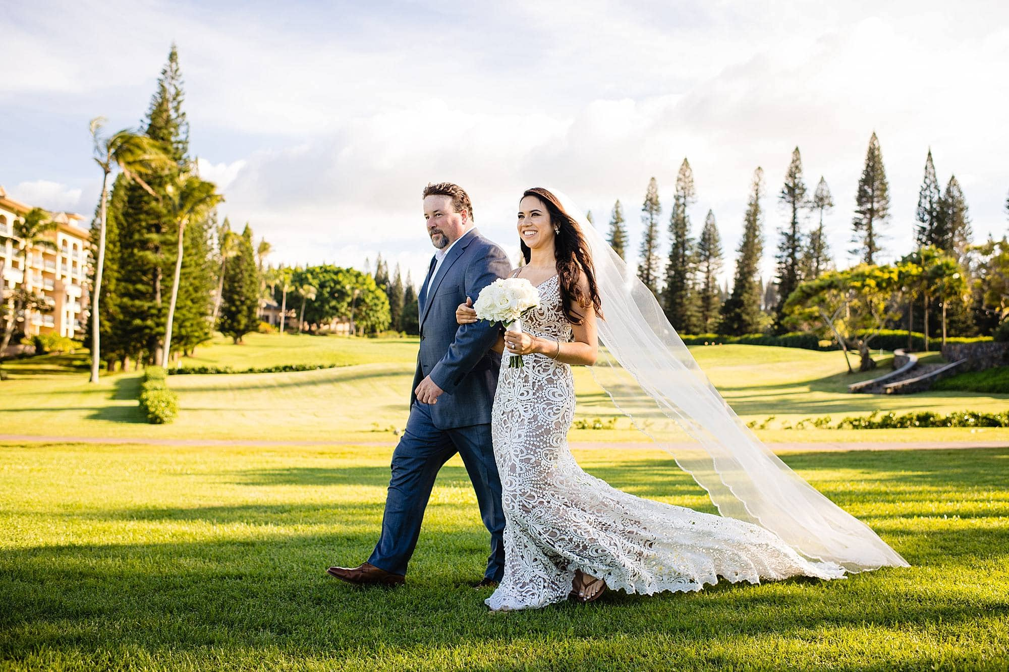father of the bride walking his daughter at ritz carlton kapalua