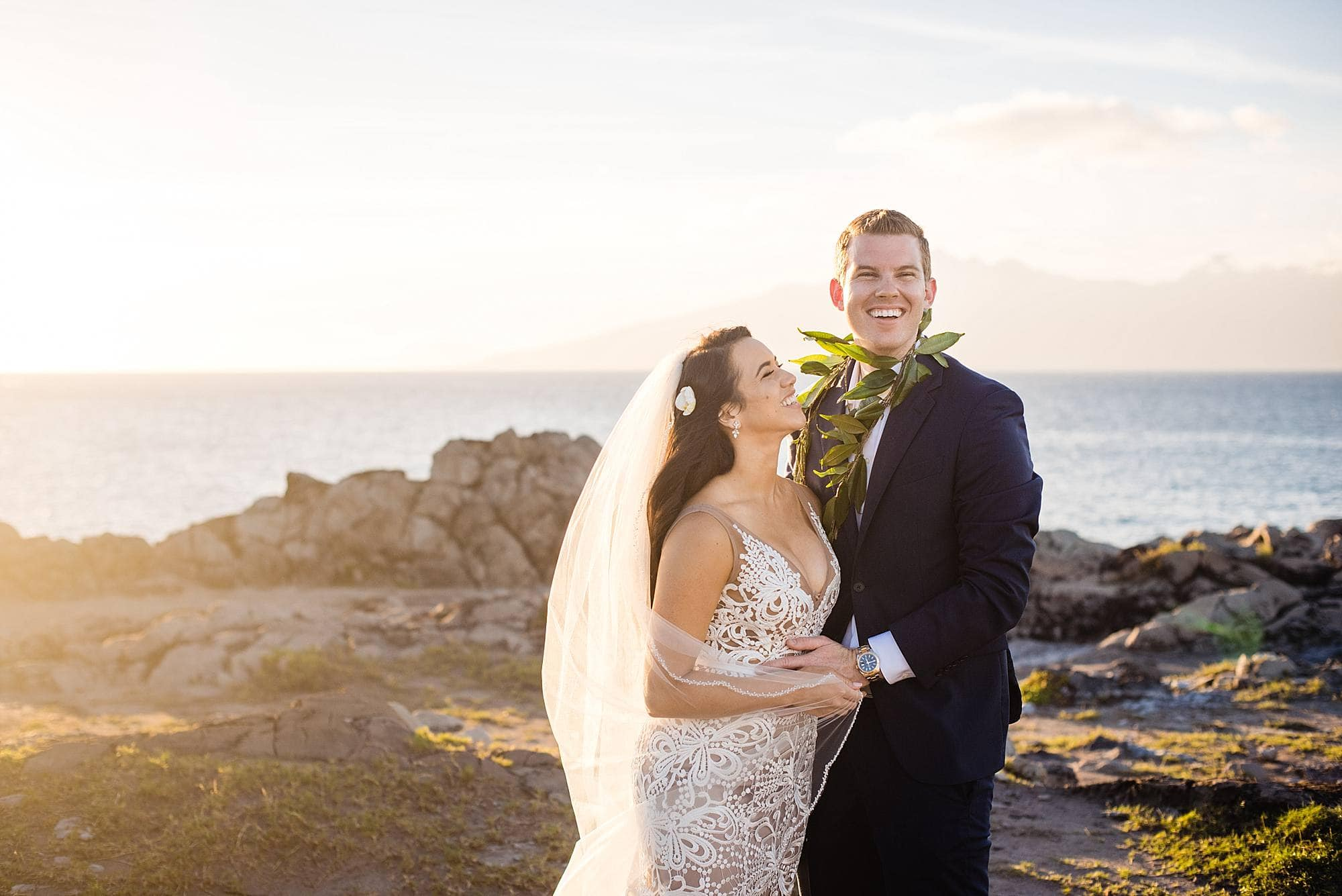 bride and groom laughing at wedding at ritz carlton kapalua