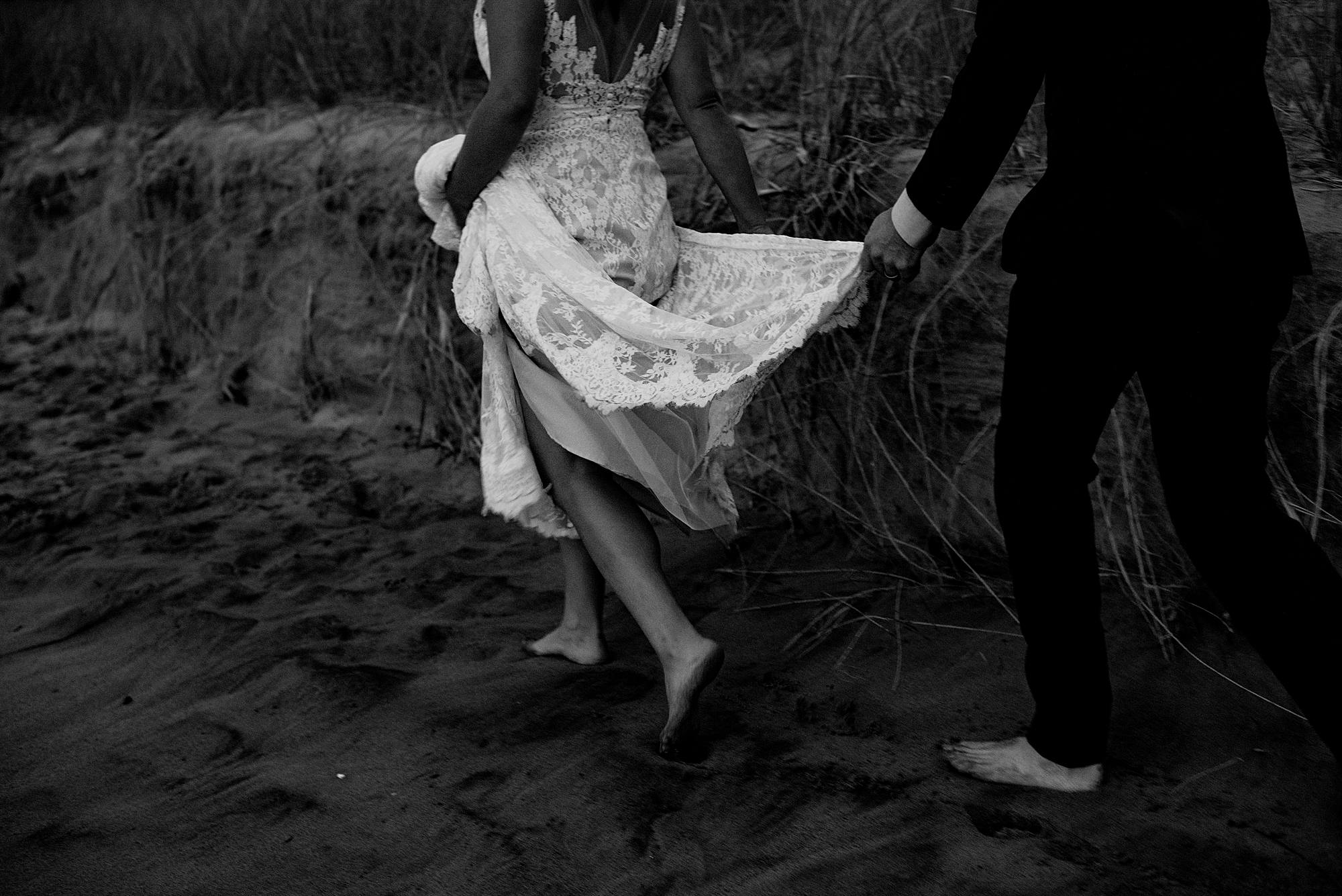 bride and groom on beach in michigan