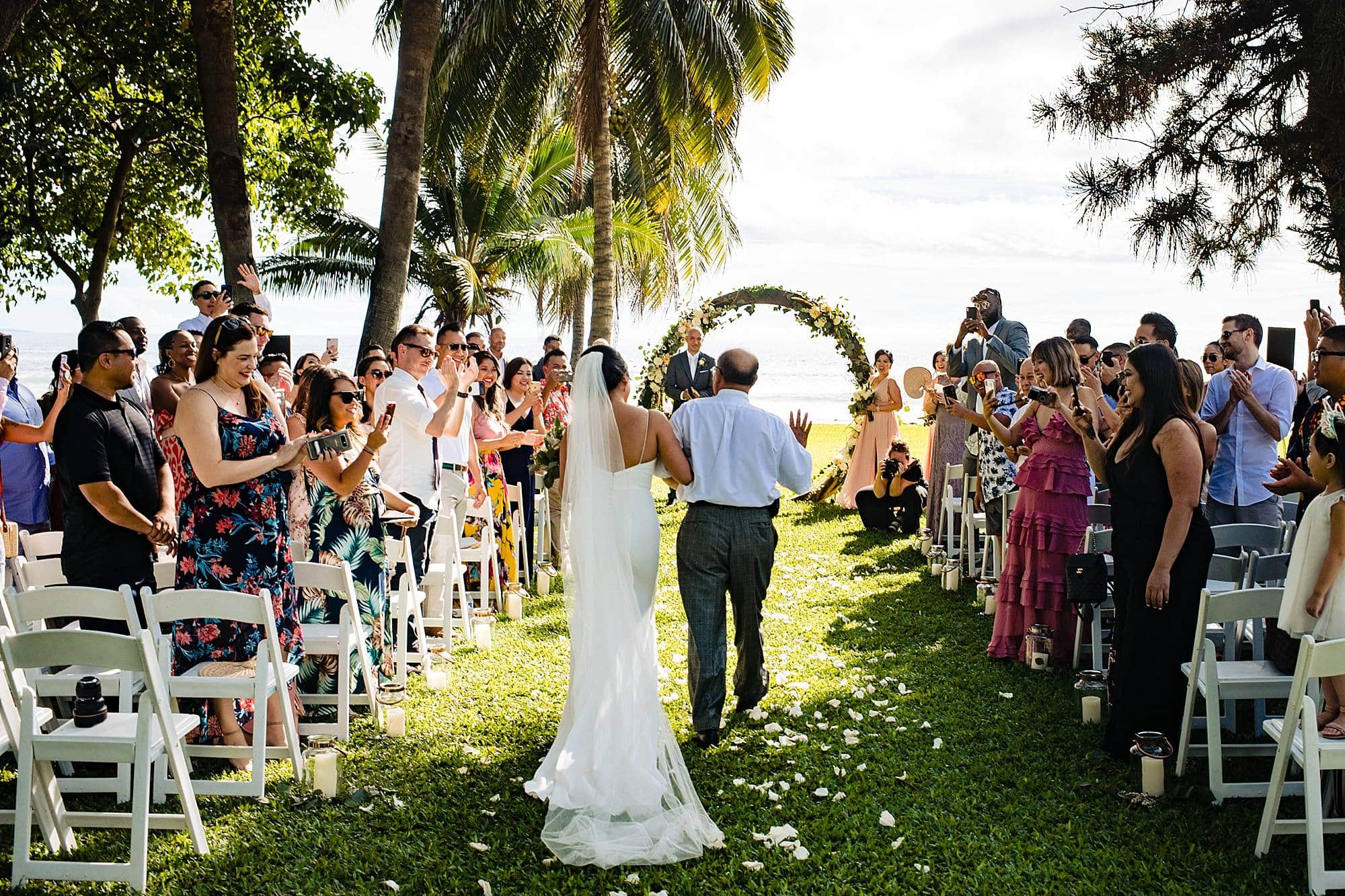 dad escorting daughter down aisle at olowalu plantation house
