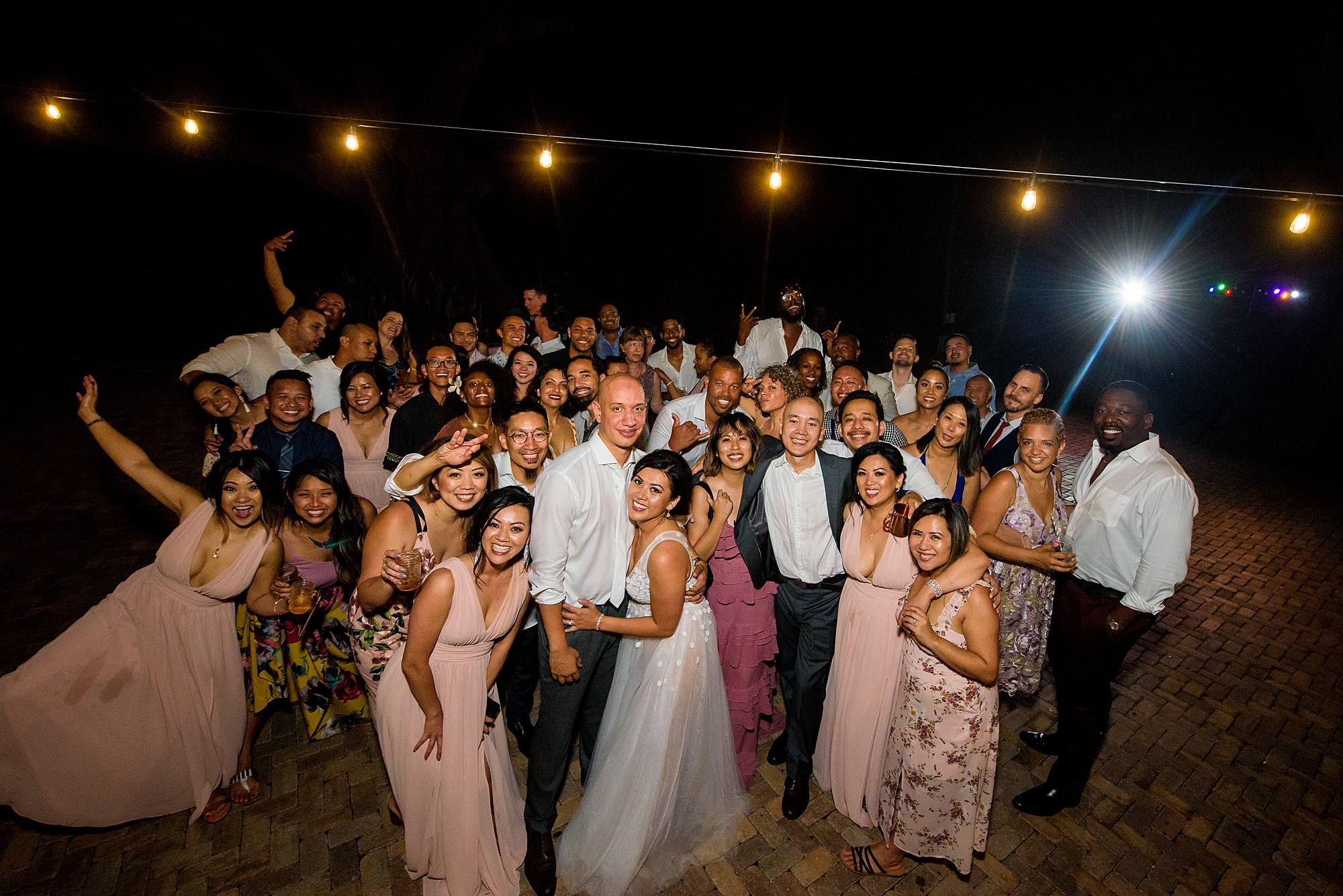 the whole party on the dance floor at olowalu plantation house