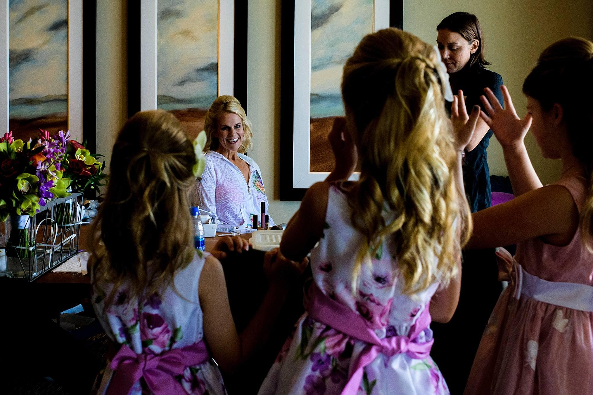 flower girls looking at bride getting ready