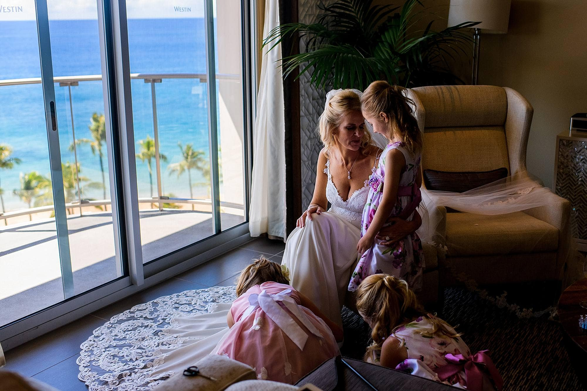 bride and her flower girls at presidential suite at westin maui