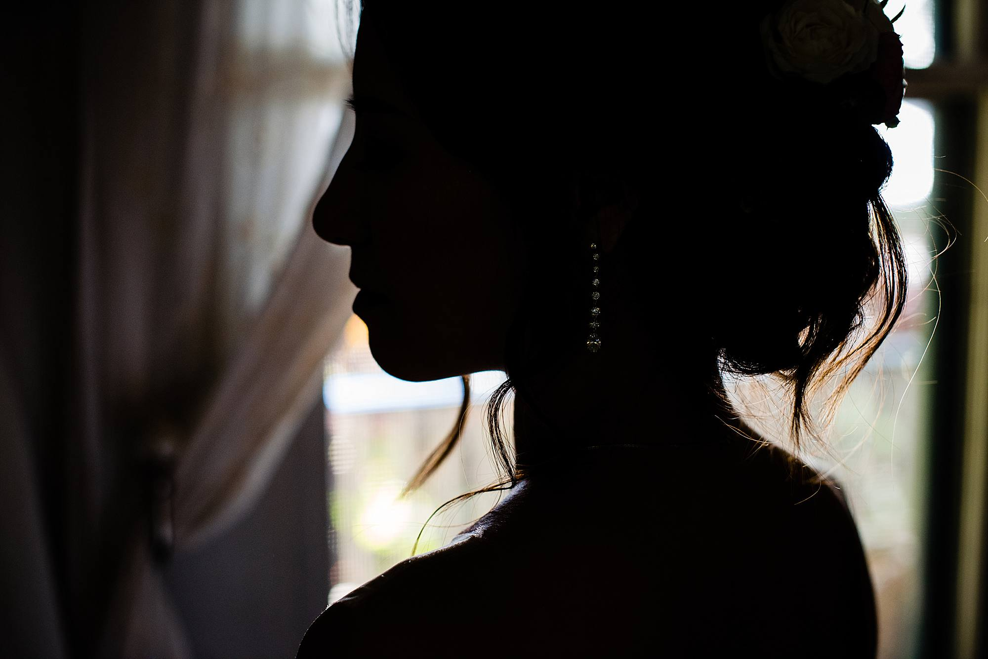 silhouette of bride and her earring at Olowalu Plantation House