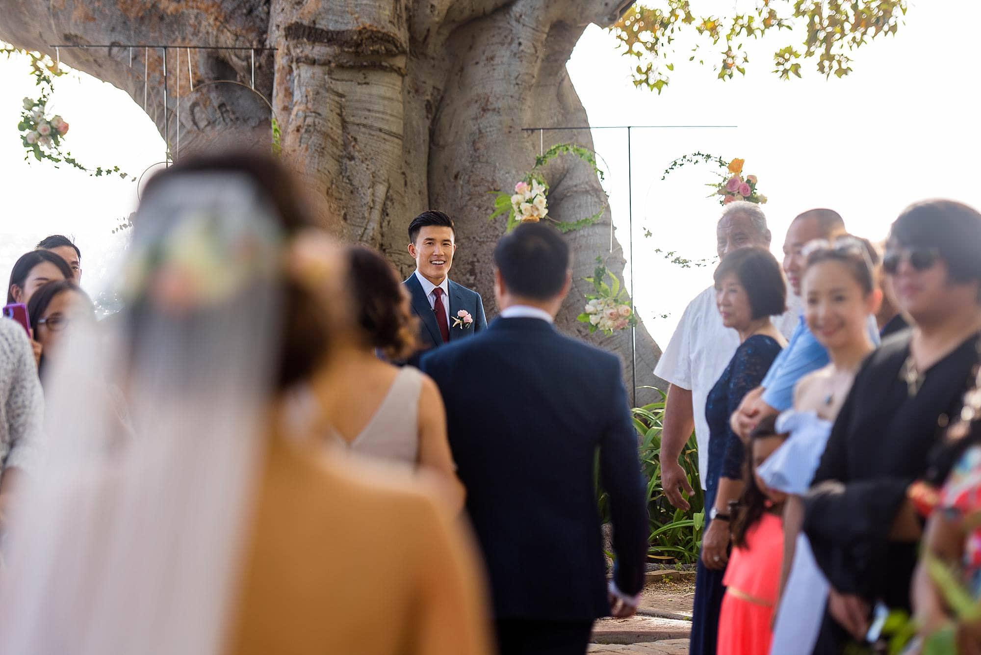 groom waiting for bride at the end of the aisle at Olowalu Plantation House