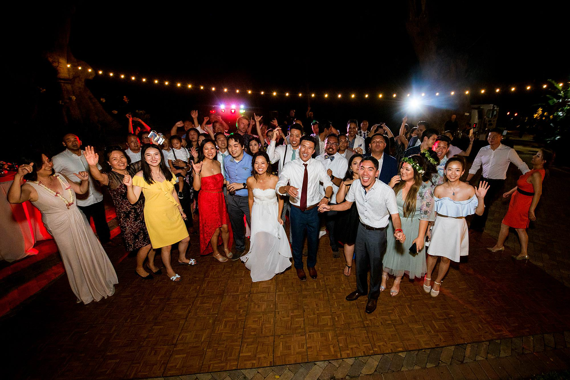 full group photo at Olowalu Plantation House wedding reception